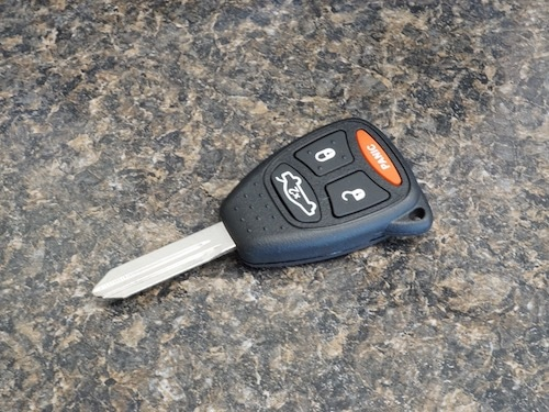 ford car key remote fob on a table