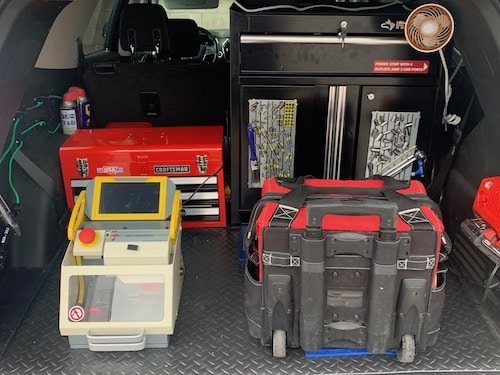 locksmith truck with key machine and tools inside
