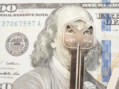 kwikset key on a $100 bill