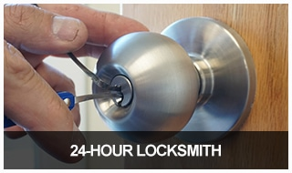 Image of a lock cylinder removed from a lock ready to be rekeyed.